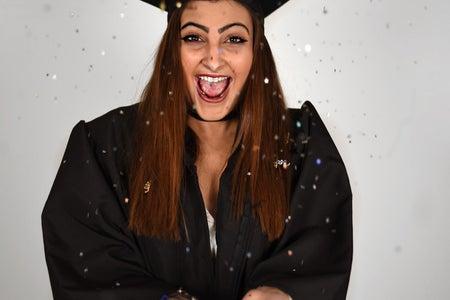 Graduate Celebrating With Confetti