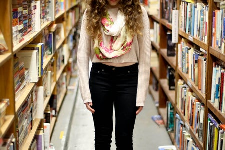 Girl In Library By Books