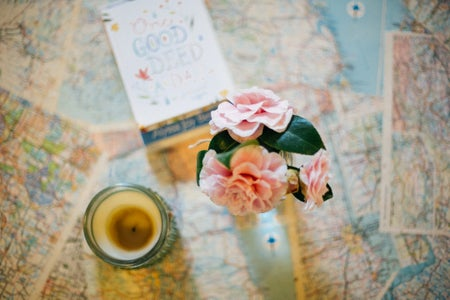 Candle And Flowers On Maps