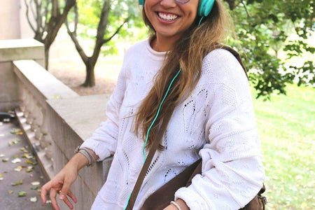The Lalagirl With Brown Backpack And Headphones