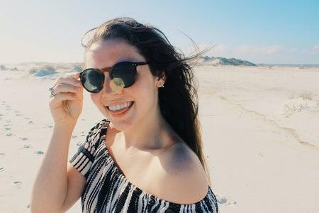Anna Schultz-Happy Girl In Sunglasses On Beach