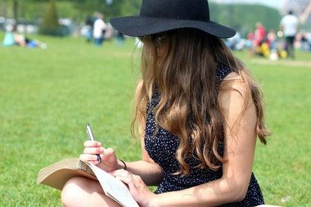 Kellyn Simpkin-Hat Girl Writing Book Grass Outside