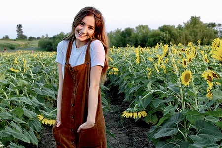Maria Scheller-Brunette Happy Girl Sunflower Field Dress Hands In Pockets