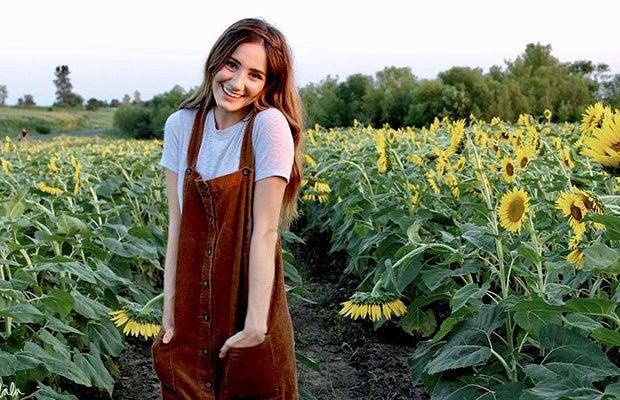 Maria Scheller-Brunette Happy Girl Sunflower Field Dress Hands In Pockets