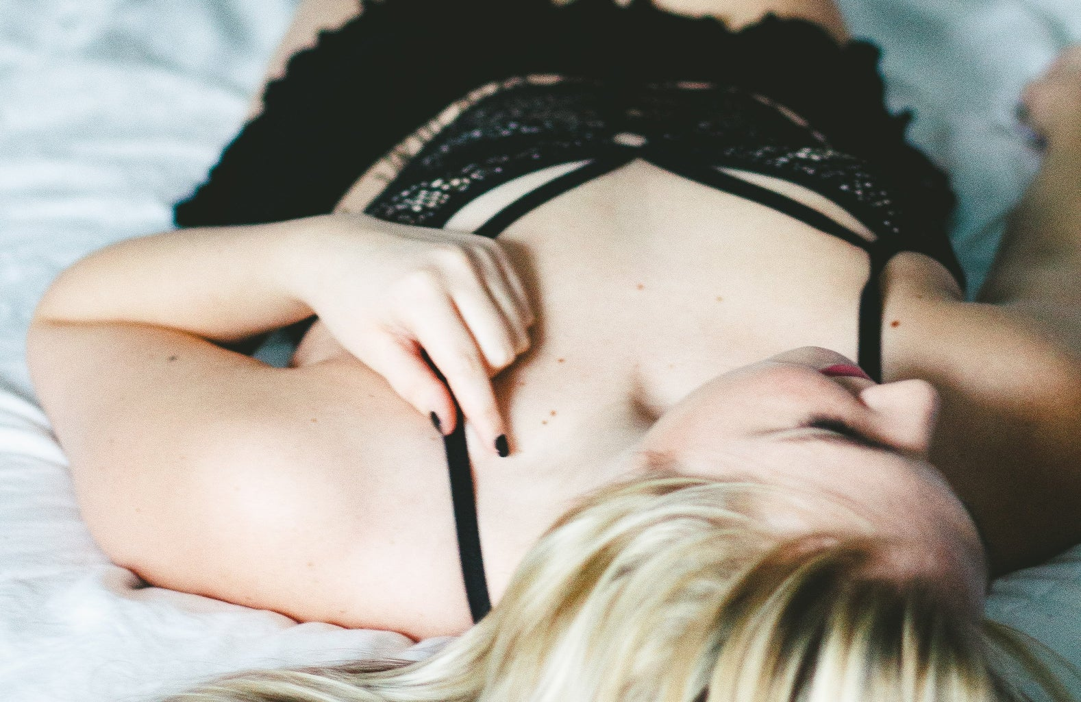 Girl Lying On Bed Close Up