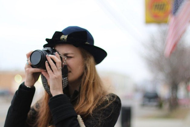 The Lalagirl In Hat Taking A Photo