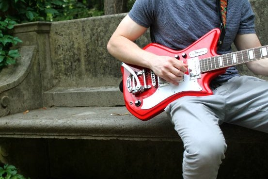Guy Red Guitar Plants Outside Bench Summer