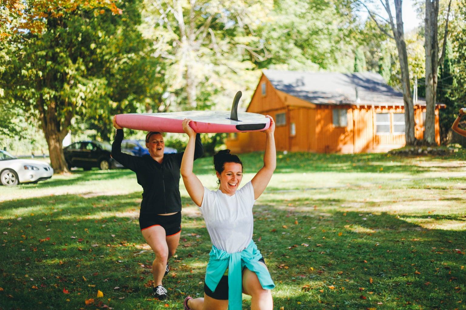 Kayla Bacon-Carrying Surfboard 2