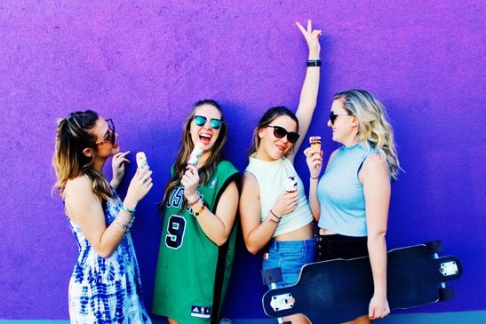 Amelia Kramer-Laughing Group Of Girls In Front Of Purple Mural
