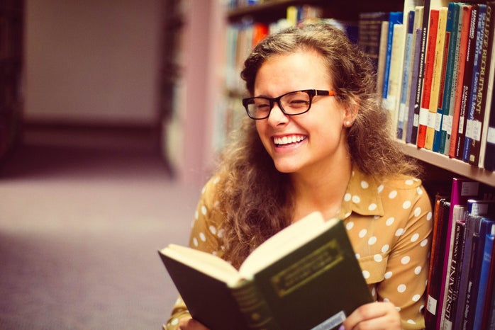 Girl With Glasses Reading Book