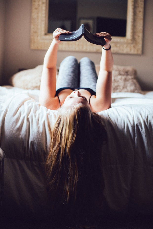 Girl Long Hair Reading Book In Bed