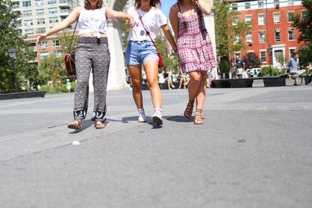 The Lalathree Friends Walking Arm In Arm