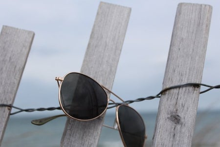 The Lalaaviator Glasses On A Fence
