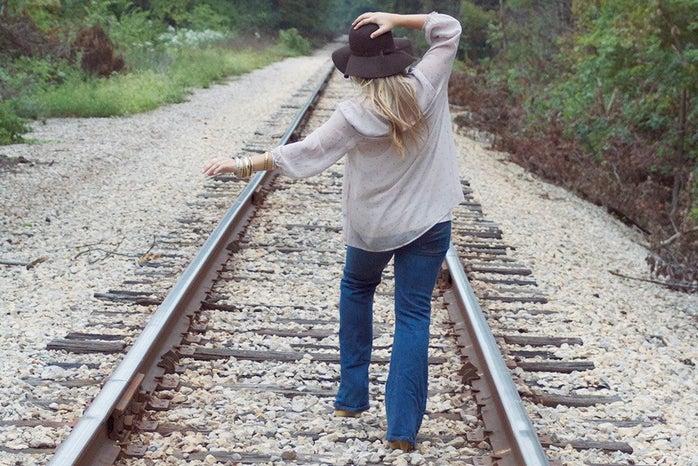 The Lalagirl Walking Down Train Tracks