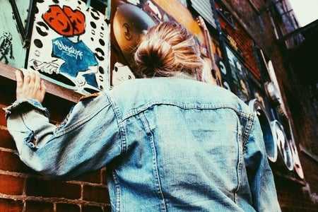 Amelia Kramer-Jean Jacket Bricks Sock Bun Mural Angle