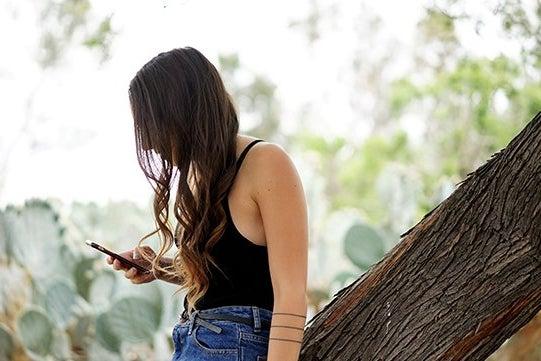Kellyn Simpkin-Girl Scrolling Phone High Waisted Jeans Watch Curly Hair Cactus