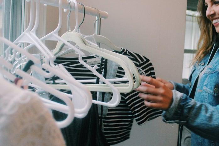 Anna Schultz-Girl Looking Through Closet