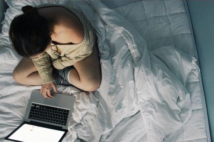 Anna Schultz-Girl Using Laptop In Cozy Bed