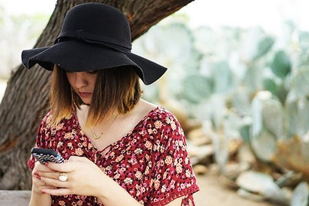 Kellyn Simpkin-Texting Hat Girl Cactus Bench Floral Shirt
