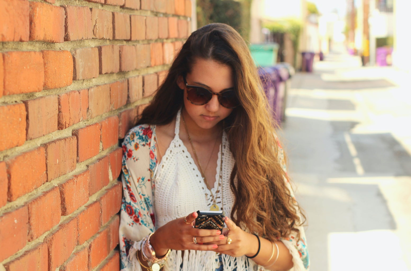 Kellyn Simpkin-Girl Next To Brick Wall Texting