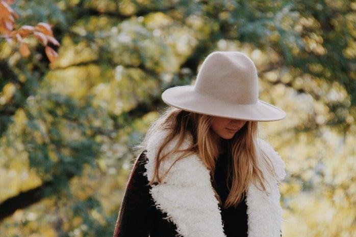 Girl Looking Down In Fuzzy Coat