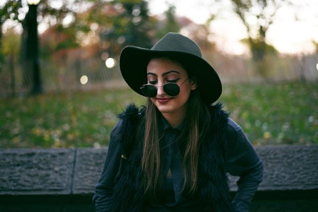 Girl In All Black With Hat And Sunglasses