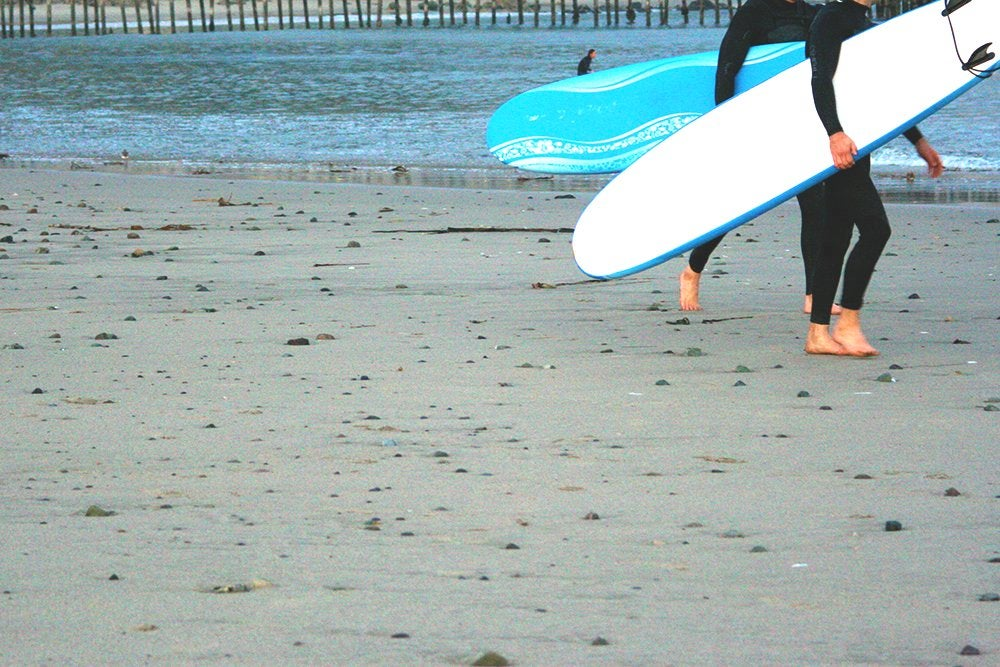 The Lalatwo Surfers With Surf Boards