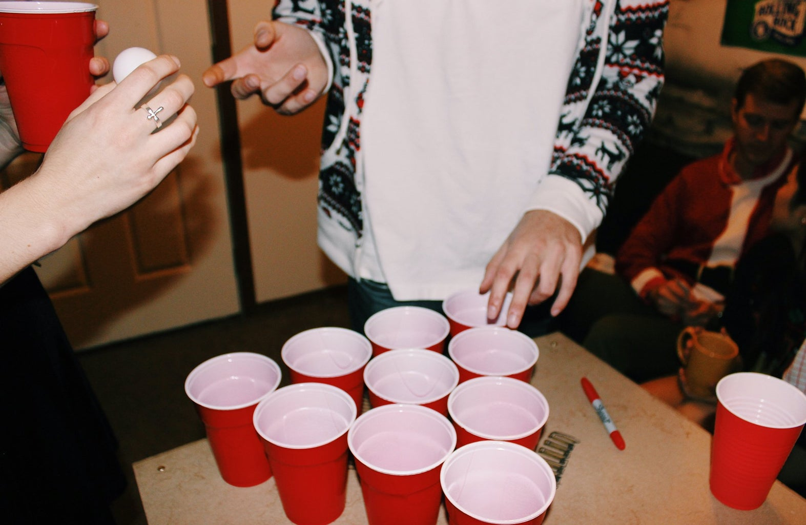 Anna Schultz-Girl And Guy Playing Beer Pong