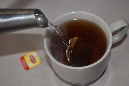 Hot Tea Pouring Water