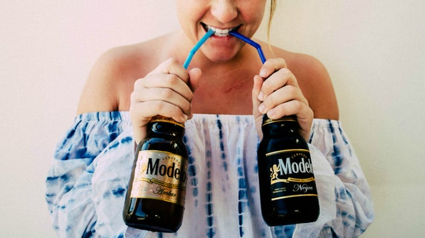 Girl Drinking Beer With Straw