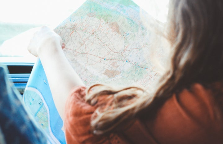 Girl Holding Map Inside Vehicle