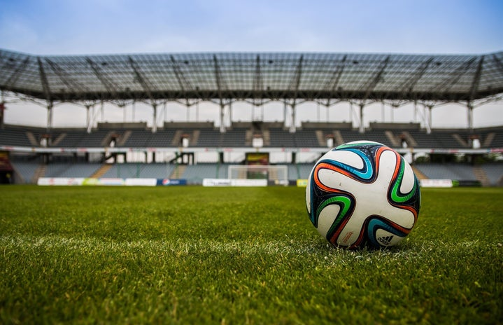 soccer ball at empty soccer stadium