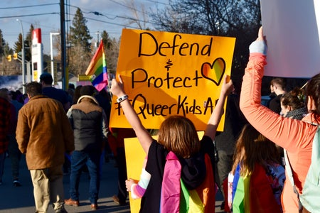 Pride parade Defend and Protect Queer Kids sign