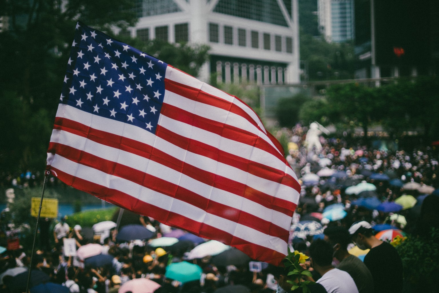 protesters waving US flags marched on Hong Kong\'s US Consulate