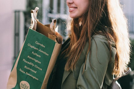 woman holding grocery bag whole foods