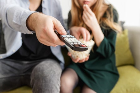 man and woman remote
