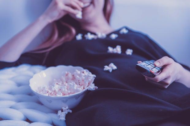 woman eating popcorn