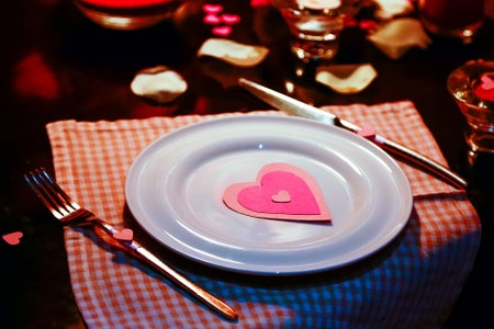 Plate on a fancy table with Valentine's Day decorations