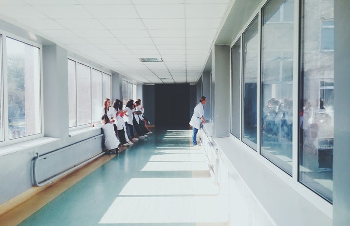 There are doctors standing in the hallway of a hospital.