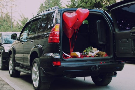 A car with a trunk set up for a valentine's date