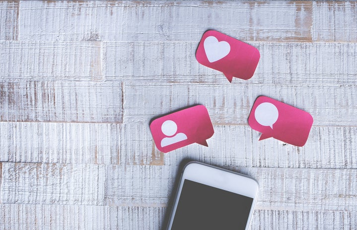 White smartphone with hearts