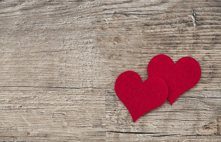 Two Felt Hearts on a wooden background