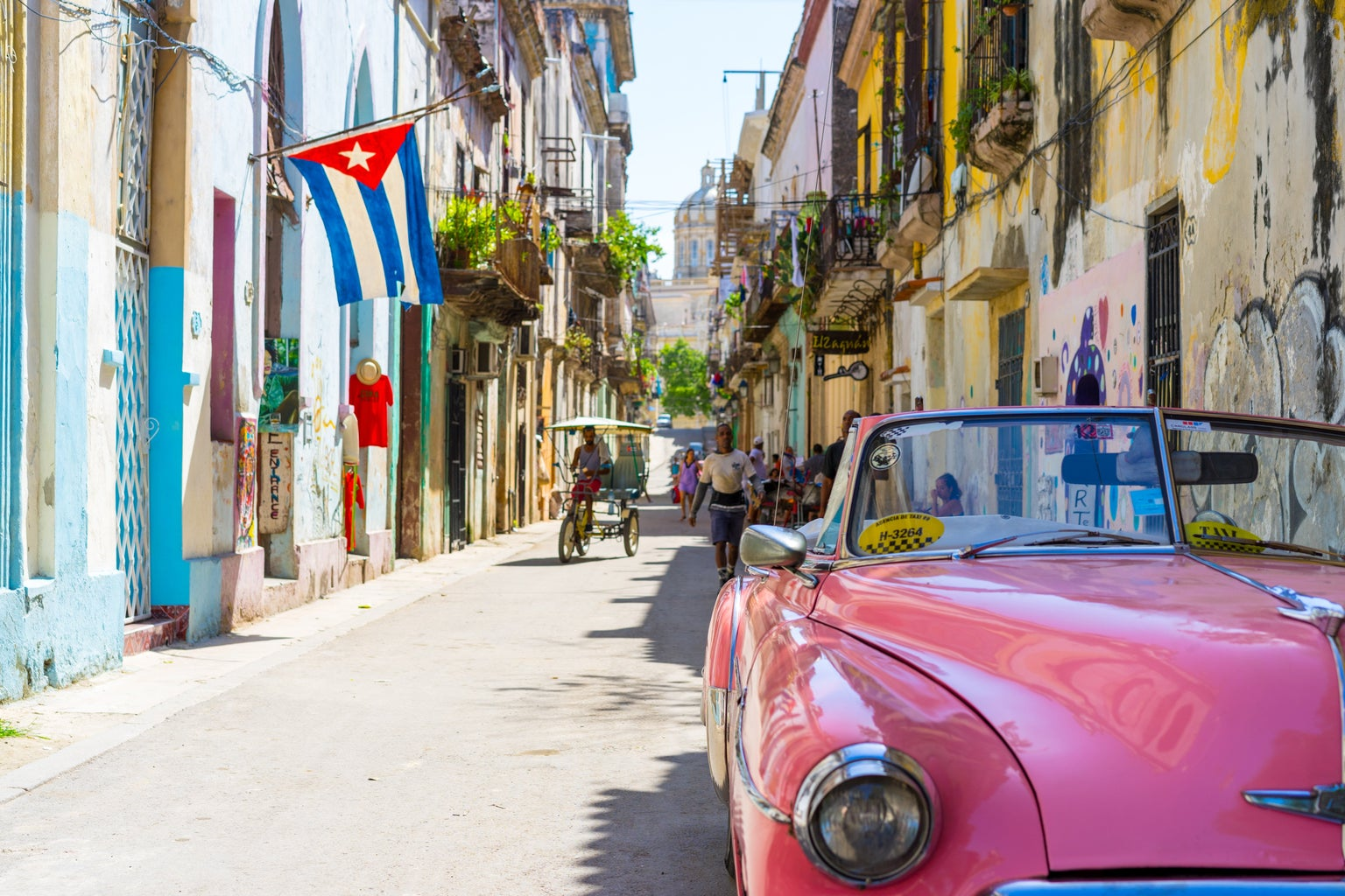 old fashioned pink convertible car in Cuba