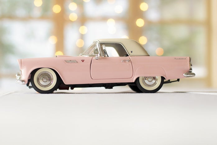 pink toy car in bright setting
