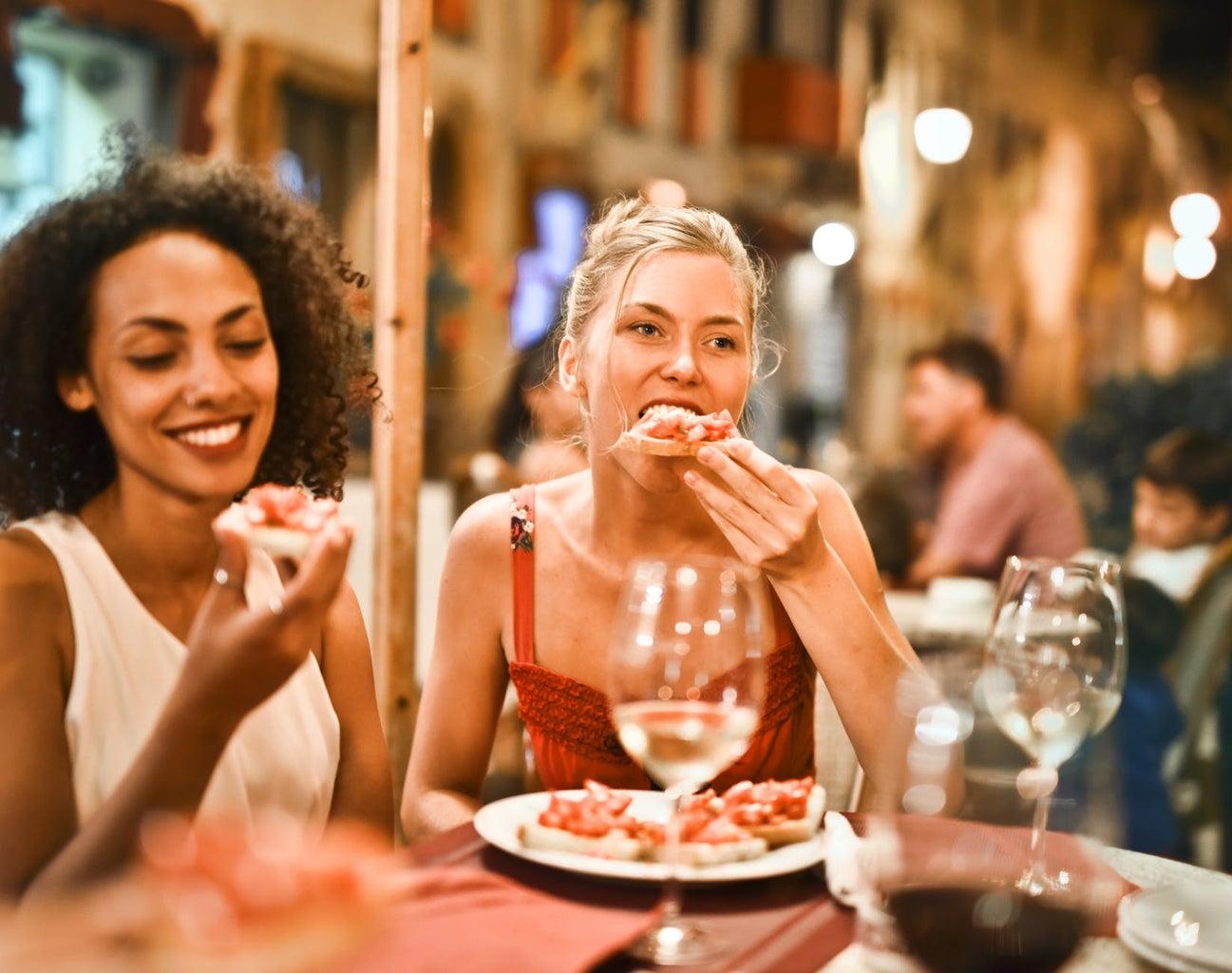 Women eating bruschetta together