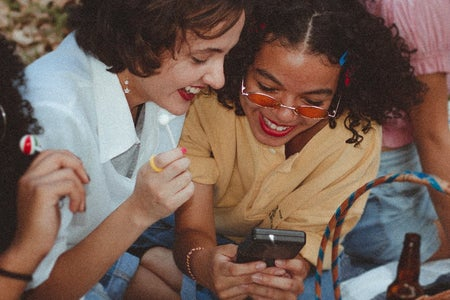 Women using gameboy together