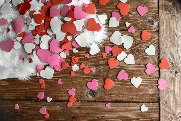 small hearts flatlay on animal skin rug