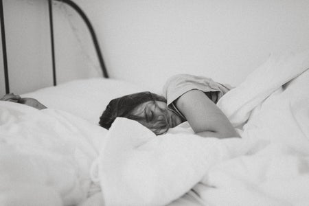 girl sleeping in black and white