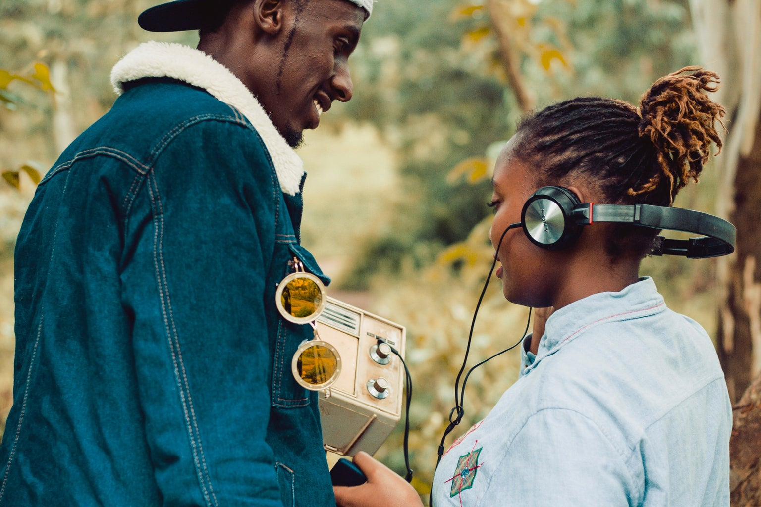 Two people listening to music