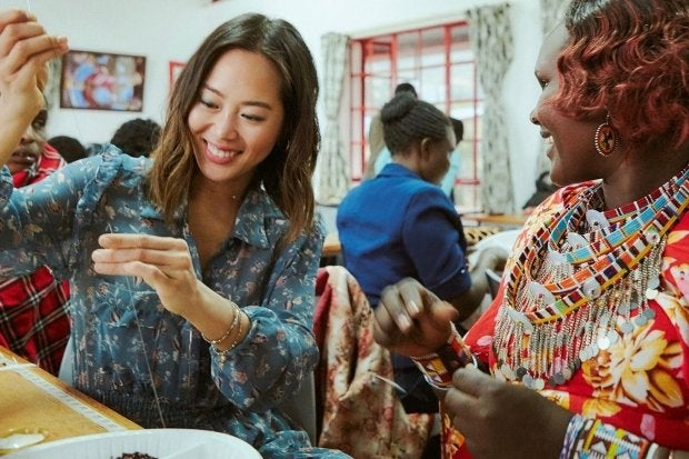 Amiee Song learning how to bead jewelry in Kenya